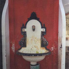 Early font at Twin Spring with single spigot and wood enclosure